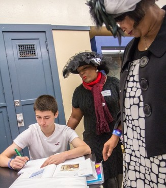 Beaumont Principal Liz Casson-Taylor and Serena Stoudamire Wesley check in with a student.